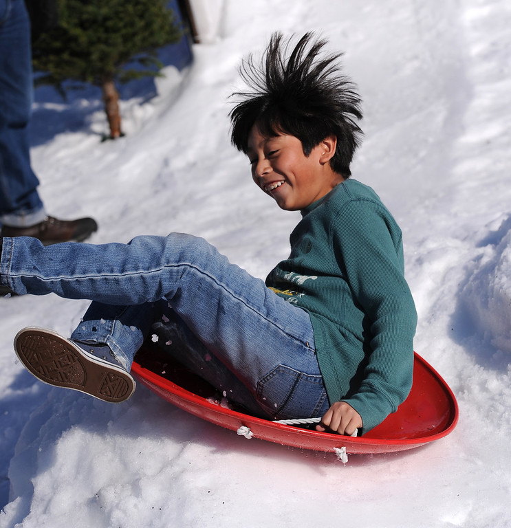 . Miguel Leal has fun on the sled track. Mattel Corp. brought lots of snow and fun games to Washington Elementary in Hawthorne for its 12 Days of Play event.  (Dec 12, 2013. Photo by Brad Graverson/The Daily Breeze)