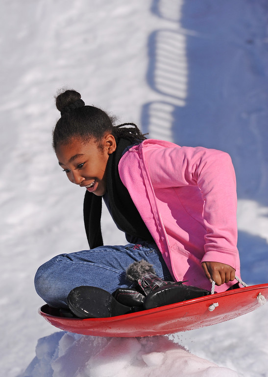 . Jazmine Stewart on the snow hill trackMattel Corp. brought lots of snow and fun games to Washington Elementary in Hawthorne for its 12 Days of Play event.  (Dec 12, 2013. Photo by Brad Graverson/The Daily Breeze)