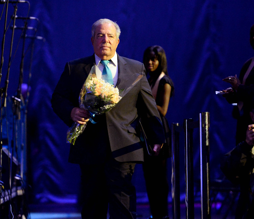 . Mayor Foster arrives with flowers for his wife Nancy before delivering his last State of the City annual address at the Pacific Ballroom at the Long Beach Arena in Long Beach, CA. on Tuesday, January 14, 2014. (Photo by Sean Hiller/ Daily Breeze).