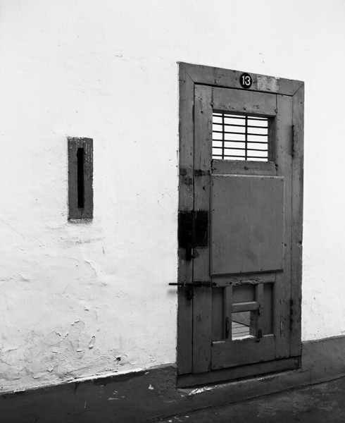 The wooden door to a jail cell in one of the wings of the Seodaemun prison in Seoul, South Korea. (Scanned from black and white film.)