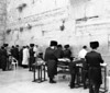 Orthodox Jews praying at the Western Wall in Jerusalem prior to the start of Shabbat. The Western Wall is the most sacred site in Judaism. (Scanned from black and white film.)