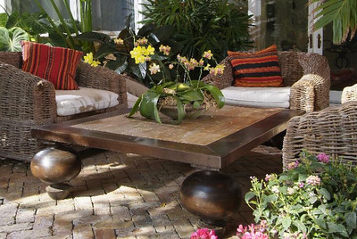"Woven vine outdoor furniture, Peruvian textile cushions, ""onion legs"" coffee table - created and designed by Artmosphere."