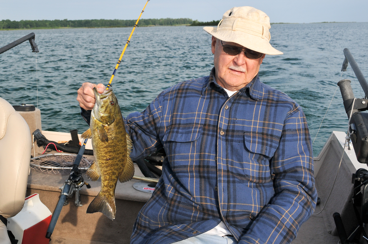 Dad with Smallmouth Bass caught near the Points - June 2009