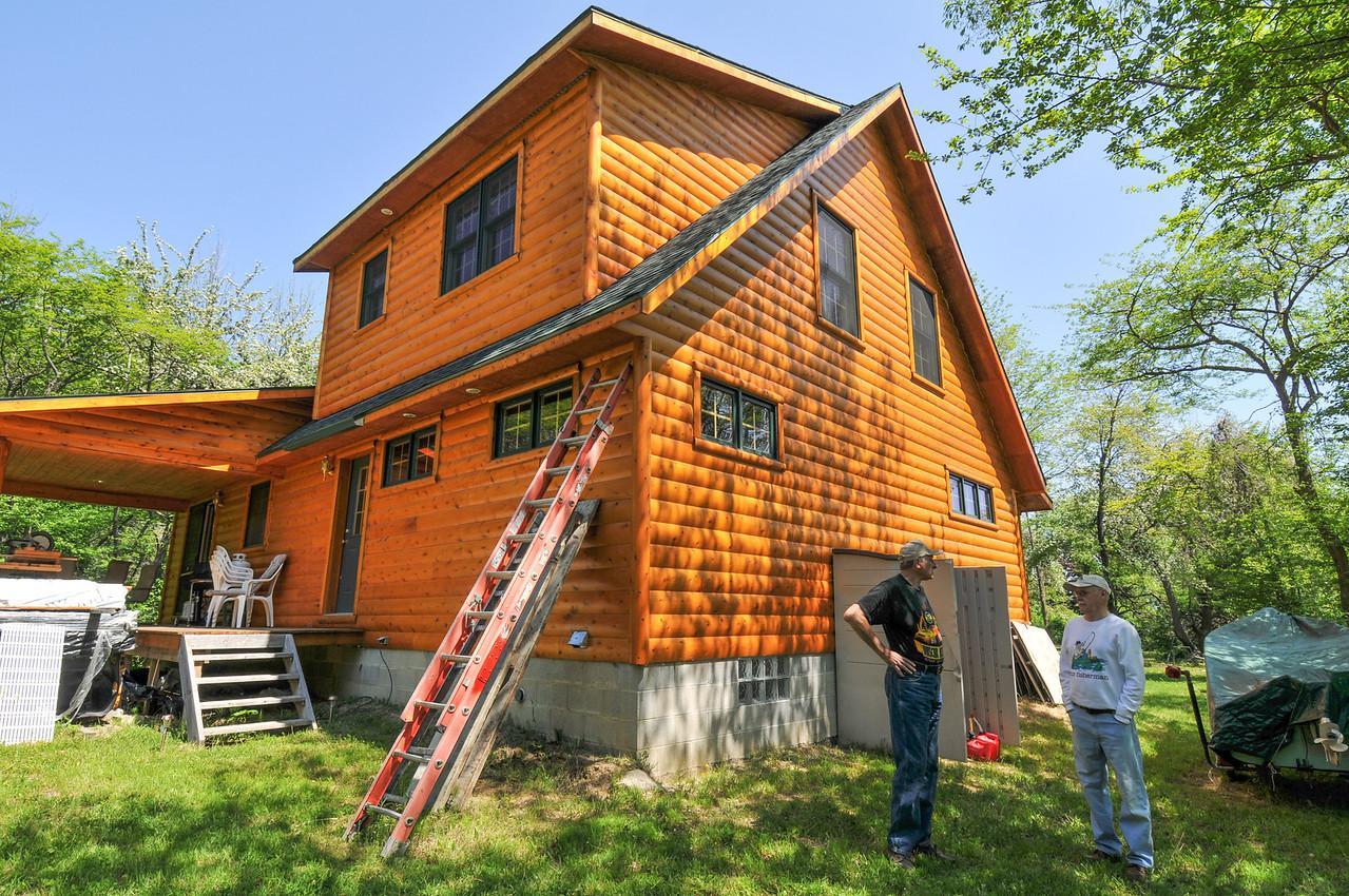 Jim Mandziuk and Dad talking outside Jim's new log home - May 2009