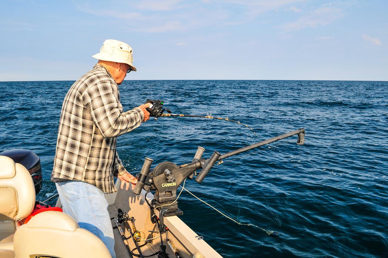 Dad adjusting the depth of his line - September 2009