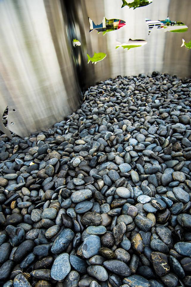 Polished black rock at base on stainless steel sculpture - Port Austin, MI - May 2013