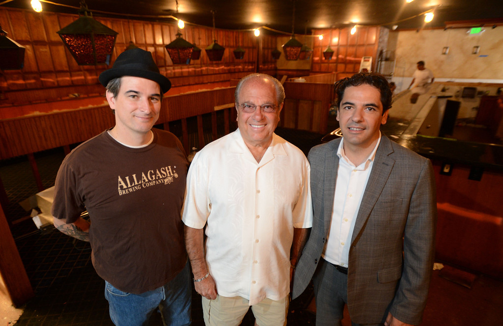 ". Long Beach, Calif., -- 08-29-13-  From left to right  Executive Chef David Coleman, Long Beach restaurateur Michael Dene,  owner of Michael\'s of Naples Restoranate and Michael\'s Pizzeria and general manager Massimo Aronne plan to open an Italian steakhouse called "" Chianina, \"" at the old Kelly\'s of Naples location, 5716 E 2nd St. They hope to open in December. 