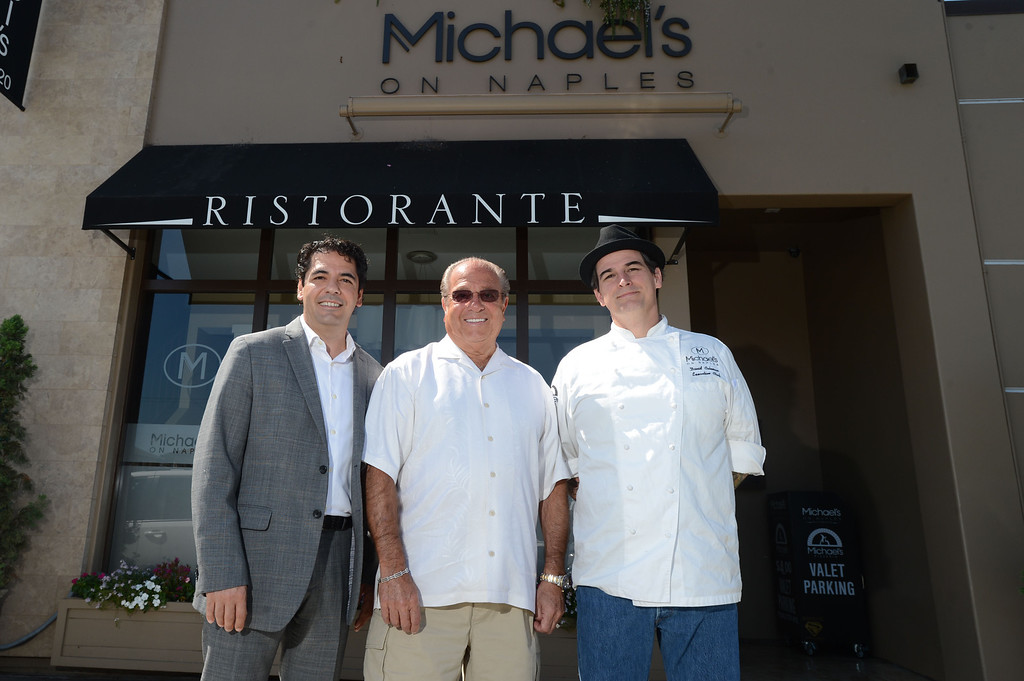 ". Long Beach, Calif., -- 08-29-13-  From left to right General manager Massimo Aronne, Long Beach restaurateur Michael Dene, owner of Michael\'s of Naples Restoranate and Michael\'s Pizzeria, Executive Chef David Coleman, plan to open an Italian steakhouse called "" Chianina, \"" at the old Kelly\'s of Naples location, 5716 E 2nd St. They hope to open in December. 