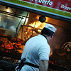 "A Uruguayan cook barbecues an assortment of different meats on a large open grill - Montevideo, Uruguay.  Travel photo from Montevideo, Uruguay. <a href=""http://nomadicsamuel.com"">http://nomadicsamuel.com</a>"