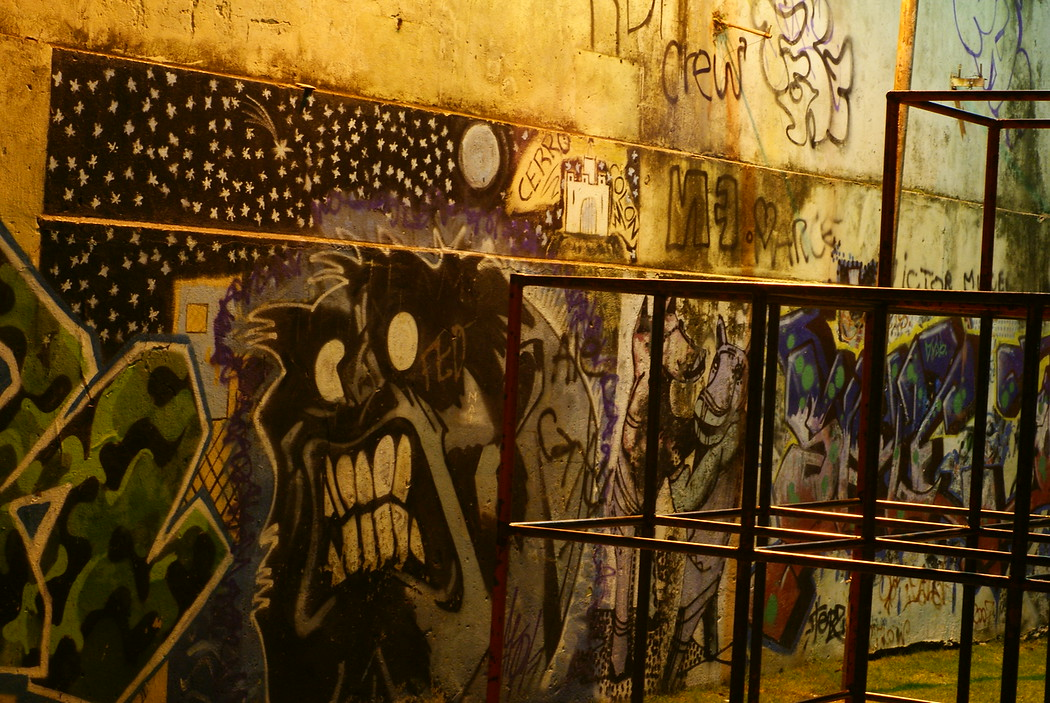A night-time shot of wall graffiti at a local playground - Montevideo, Uruguay.  This is a travel photo from Montevideo, Uruguay.
