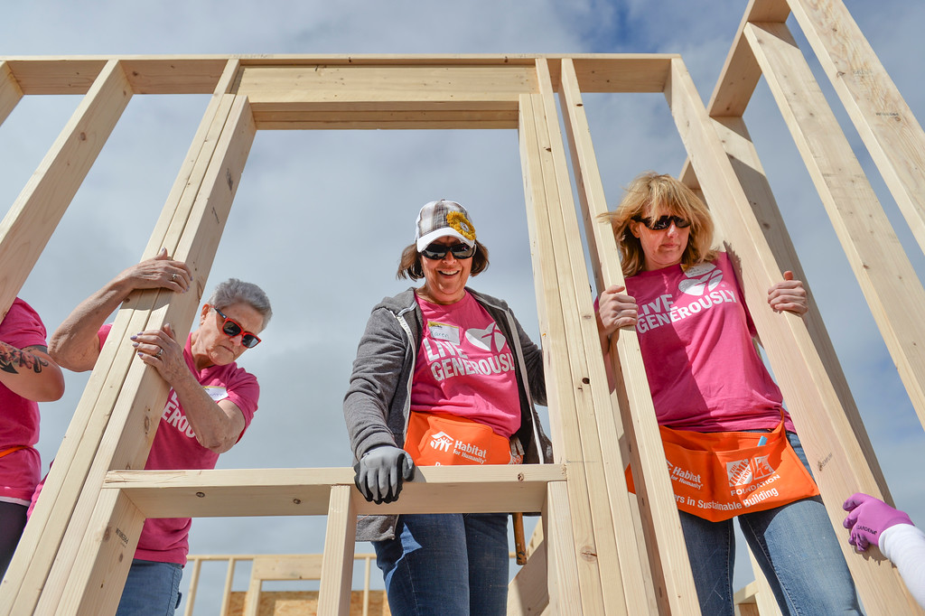 "Justin Sheely | The Sheridan Press<br /> Volunteers, from left, Martha Wallace, Karen Engen and Renae Morris hold a stud wall in place during ""Hammering from the Heart"" Women Build with Habitat for Humanity Saturday at the Peak's home at Poplar Grove. The all-woman volunteer crew worked on homes with Habitat for Humanity of the Eastern Bighorns throughout the day in conjunction with Habitat's National Women Build Week."