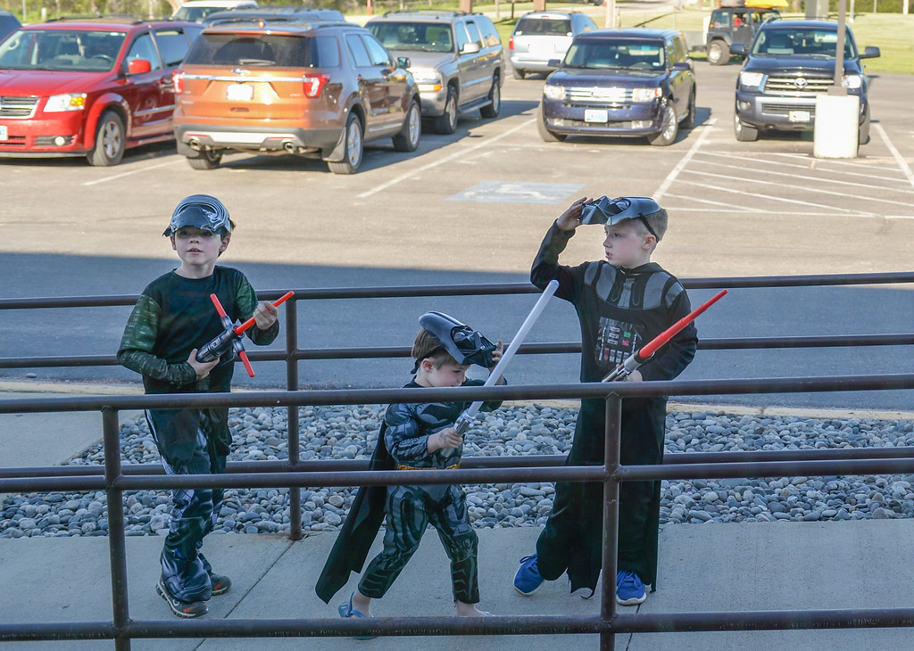 Justin Sheely | The Sheridan Press<br /> Seven-year-old Piersen Resser, left, Bennett Resser, 3, and Evan Yager, 7, walk to the entrance of the building during the Mother and Son Star Wars Date Night Friday at the Tongue River Community Center. The Star Wars themed event was to provide a fun opportunity for moms and their sons for Mother's Day Weekend.