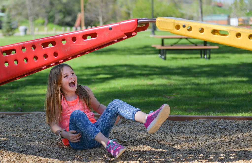 Justin Sheely | The Sheridan Press<br /> Seven-year-old Haylee Wagnor reacts after falling off the playground with her friends of the YMCA after school program Wednesday at Kendrick Park.