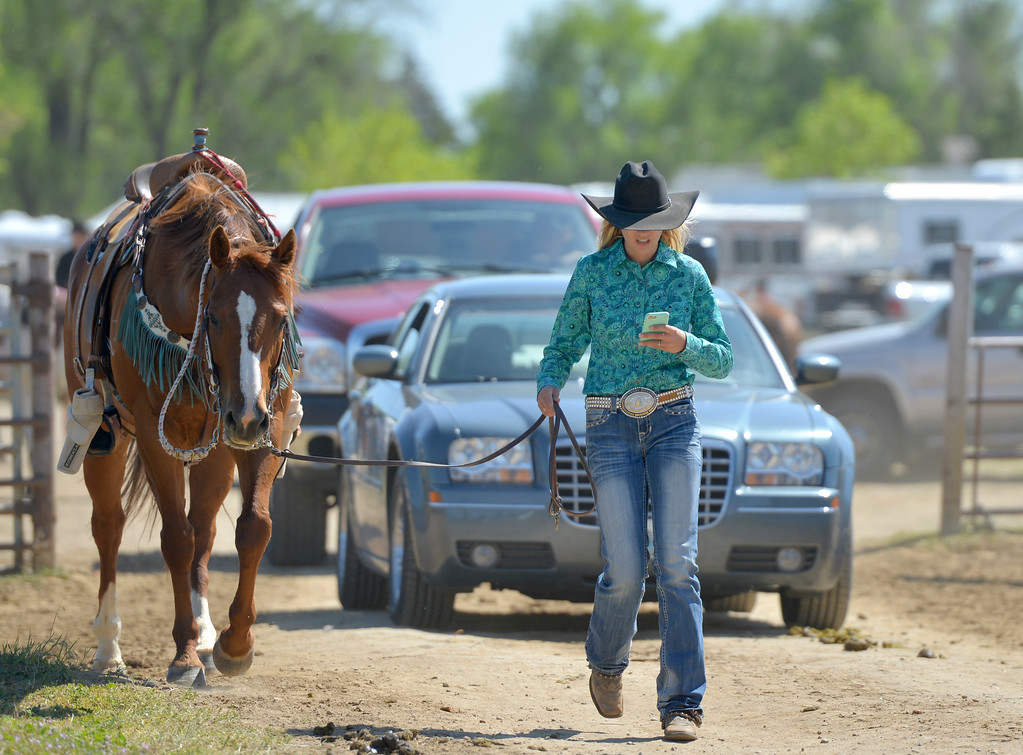 Justin Sheely | The Sheridan Press<br /> Emmy O'Connell of Gillette walks her horse to the trailer to cool off during the Sheridan County high school rodeo Monday at the Sheridan County Fairgrounds.