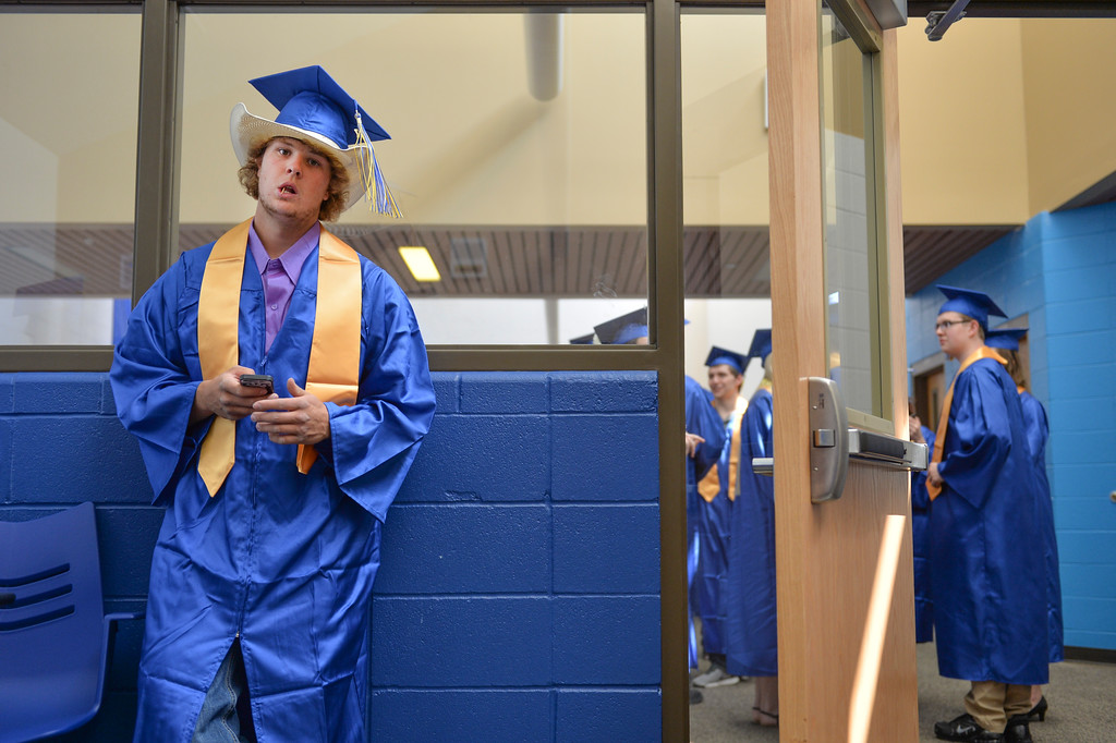 Justin Sheely | The Sheridan Press<br /> Bryson Miranda waits on his phone prior to the 2017 graduation ceremony Saturday at Sheridan High School.