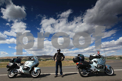 One rider and two BMW motorcycles...decisions, decisions...which one to ride.