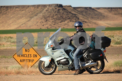 BMW rider stopped along the highway adjacent to an airstrip in Murphy, Idaho....a very small town consisting on one store.