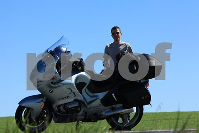 BMW rider taking a break along the highway that runs through the wheat fields of southeast WA state.