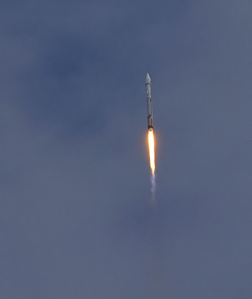 The Atlas V carrying MAVEN to Mars soars into the thin cloud layers.