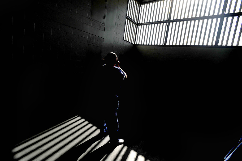 . A female inmate gets some sunshine after seeing the portrait of Our Lady of Guadalupe at Sunday Mass for incarcerated women at the Los Angeles County Century Regional Detention Facility in Lynwood on Sunday, Nov. 17, 2013. (Photo by Sean Hiller/Long Beach Press Telegram)