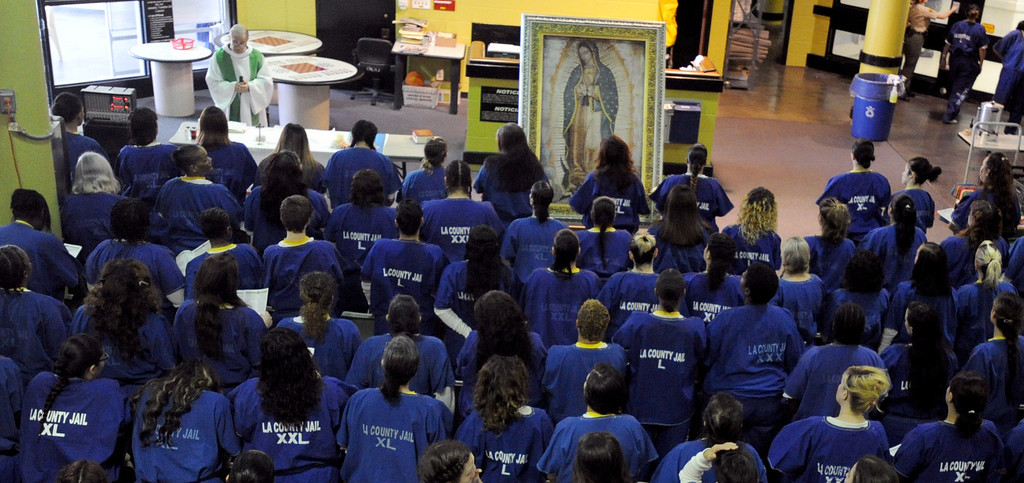 . The pilgrimage of the images of Our Lady of Guadalupe and St. Juan Diego resumed Sunday with morning Mass for incarcerated women at the Los Angeles County Century Regional Detention Facility in Lynwood on Sunday, Nov. 17, 2013. (Photo by Sean Hiller/Long Beach Press Telegram)