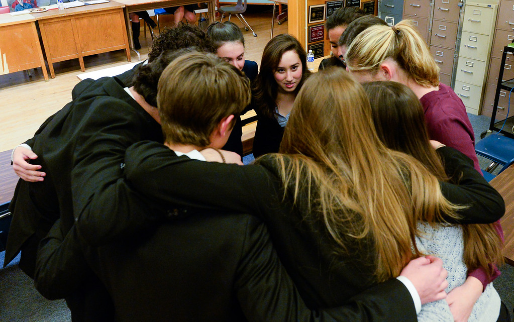 . Redlands High School mock trial member Tiffany Rekem and her teammates huddle before competing in a scrimmage mock trial against Arrowhead Christian Academy at Redlands High School in Redlands, Calif. on Tuesday, March 7, 2017. Redland High School\'s mock trial team will head to the state championship. (Photo by Rachel Luna, Redlands Daily Facts/SCNG)
