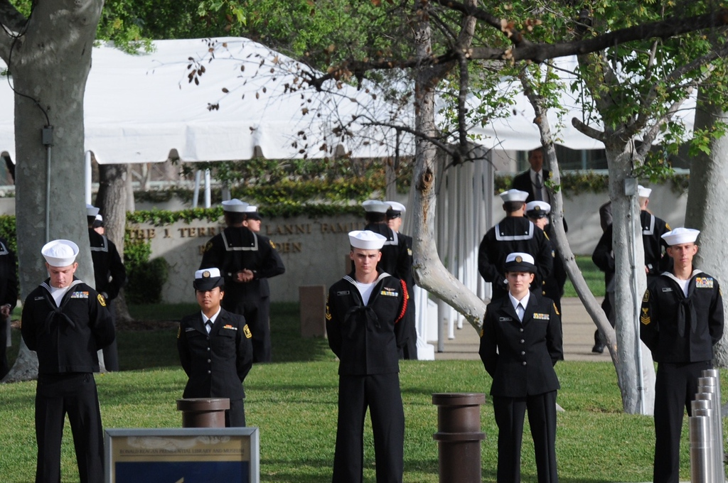 . Sailors gather early Friday, March 11, near a portrait of the late Nancy Reagan in the hours before funeral services and burial for the former first lady at the Reagan Presidential Library in Simi Valley. (Photo by Dean Musgrove/Los Angeles Daily News)