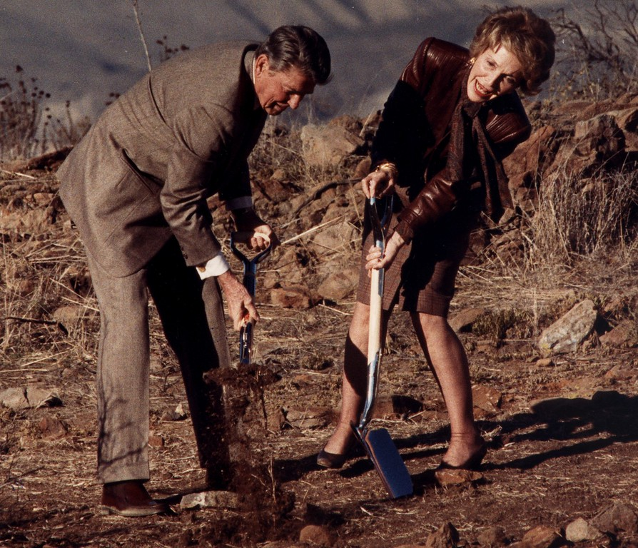 . 11/21/88--Simi Valley-President Ronald Reagan shovels dirt while Nancy struggles to break the surface during a ground breaking ceremony for the new Reagan Library in Simi Valley. (John McCoy/Los Angeles Daily News)