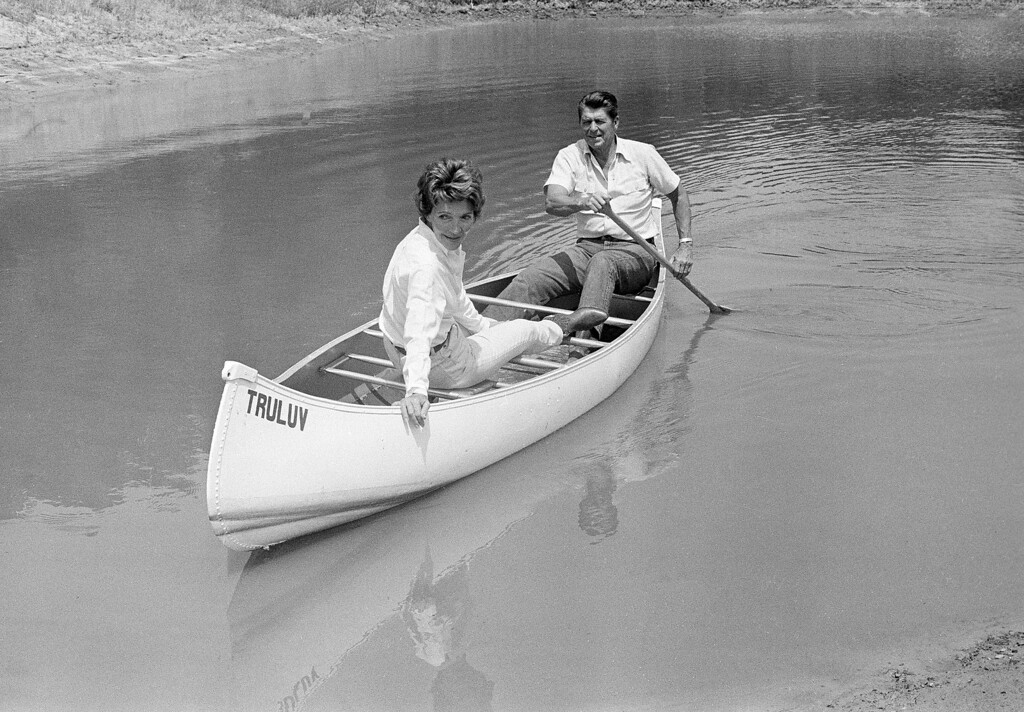 . Ronald Reagan took his wife Nancy for a canoe ride on a pond at their mountain ranch near Santa Barbara, Calif., on July 27, 1976.    (AP Photo/Walter Zebowski)