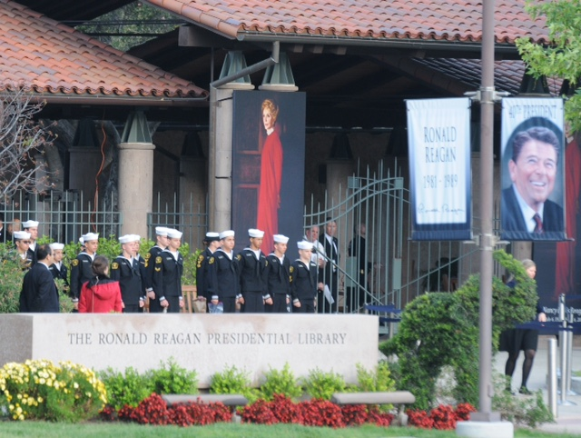 . Sailors gather early Friday, March 11, 2011, near a portrait of the late Nancy Reagan in the hours before funeral services and burial for the former first lady at the Reagan Presidential Library in Simi Valley. (Photo by Dean Musgrove/Los Angeles Daily News)