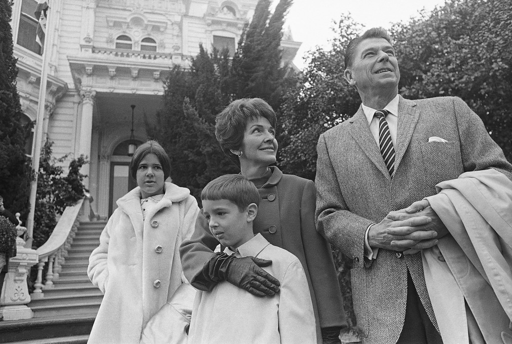 . Ronald Reagan, California\'s Republican governor-elect, poses for pictures with his wife, Nancy, and children Ronald Jr., 8, and Patricia, 13, outside the Executive Mansion in Sacramento, Calif., on Jan. 1, 1967.   The Reagans were moving into the mansion prior to his post-midnight oath taking ceremony tonight. (AP Photo/Walt Zeboski)