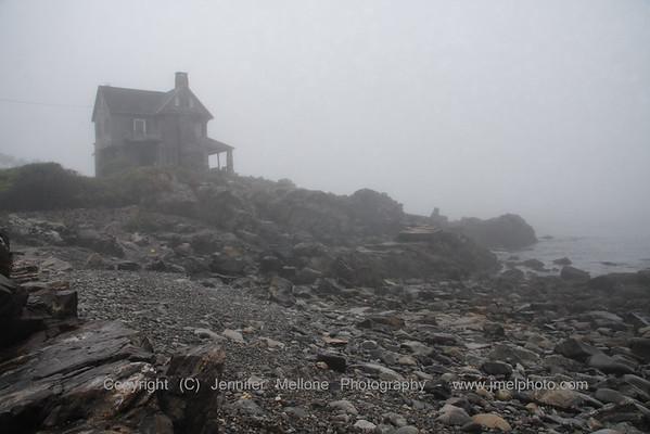 House in the Fog on a Maine Rocky Beach