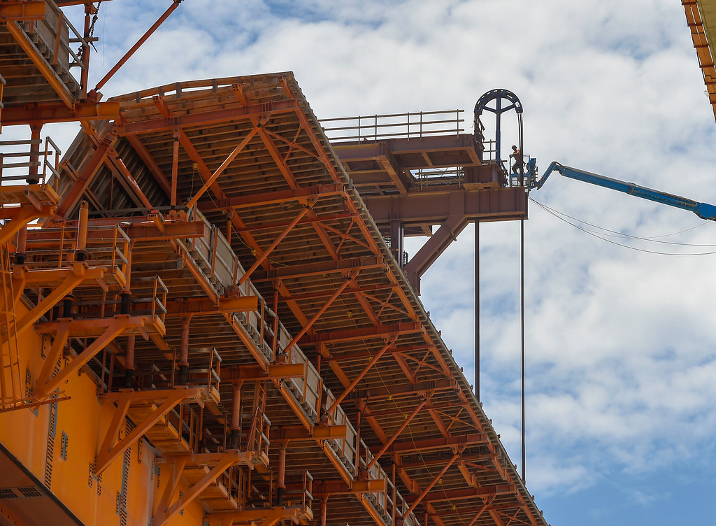 . Construction crews spent the day slowly raising a giant orange colored scaffolding system into place to build the eastbound roadway of the new Gerald Desmond Bridge in Long Beach on Tuesday, August 1, 2017. The 3.1-million pound platform was slowly lifted into place on two bridge support columns. The scaffolding recently completed 3,000-foot segment of the westbound lanes and was moved to begin building the eastbound lanes. (Photo by Scott Varley, Press-Telegram/SCNG)