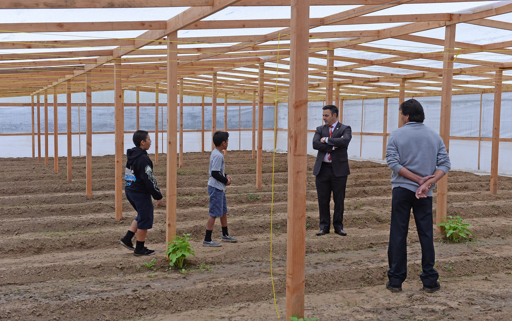 . LA City Councilman Joe Buscaino and greenhouse builder Gaetano Di Bennardo look over the new greenhouse at Rolling Hills Prep School. The hothouse will enhance the school\'s horticulture program. Photo by Brad Graverson/The Daily Breeze 11/21/13