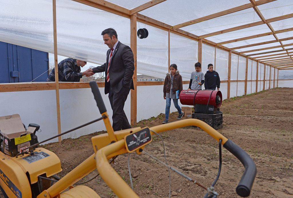 . LA City Councilman Joe Buscaino tours the new greenhouse at Rolling Hills Prep School, which will enhance the school\'s horticulture program. Photo by Brad Graverson/The Daily Breeze 11/21/13