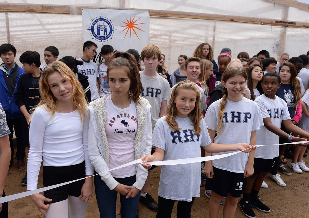 . Students gather at Rolling Hills Prep School near their new greenhouse,which will enhance the school\'s horticulture program. Photo by Brad Graverson/The Daily Breeze 11/21/13
