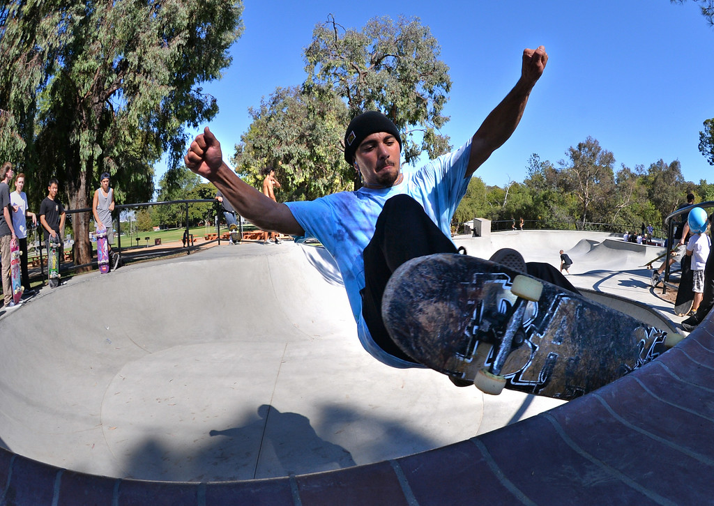 . Zack Bell from San Pedro shreads the rail at the new San Pedro skatepark located in Peck Park along Western Ave. in SP. (Aug. 15 2014 Photo by Brad Graverson/The Daily Breeze)