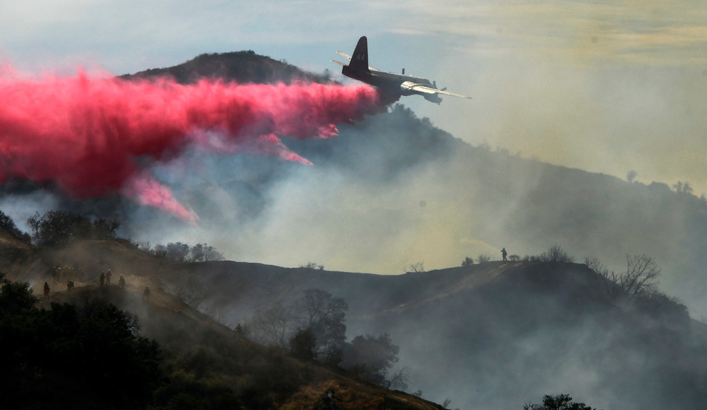 . July 13,2017.  Santa Clarita  CA.  Air tankers make drops to help out LA county, LA city and Angeles Forest firefighters battle a small brushfire in Santa Thursday. The fire quickly burn  20-acres that destroyed one outbuilding, while threatening more than a dozen structures,  Photos by Gene Blevins/LA DailyNews/SCNG