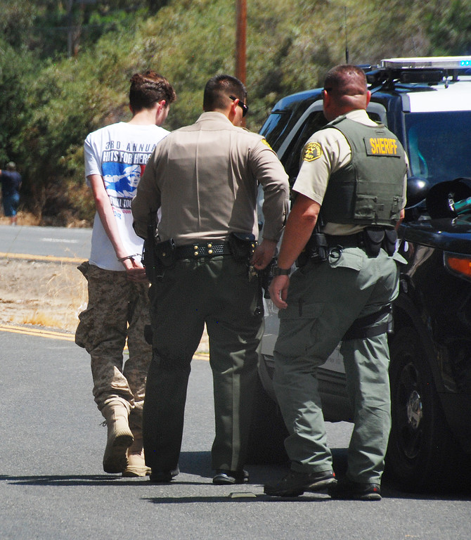 . A suspect in the setting of a brush fire in the Newhall Pass this afternoon is taken into custody. He was in a paintbal park and set off a smoke bomb.