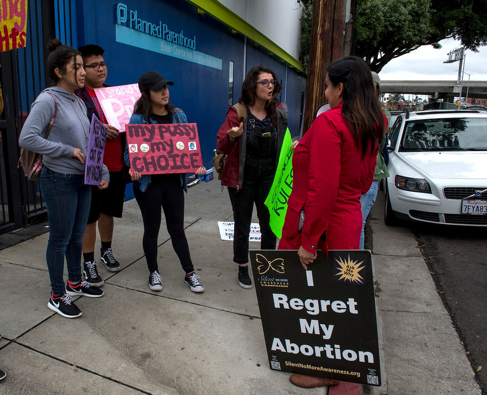 . Irene Zamorano, right, Pro-Life, confronts Alex Maynard, Pro-Rights, during a Pro-Life Prayer Vigil at Planned Parenthood Bixby Center for Reproductive Health in Los Angeles on Saturday, February 11, 2017. (Photo by Ed Crisostomo, Los Angeles Daily News/SCNG)