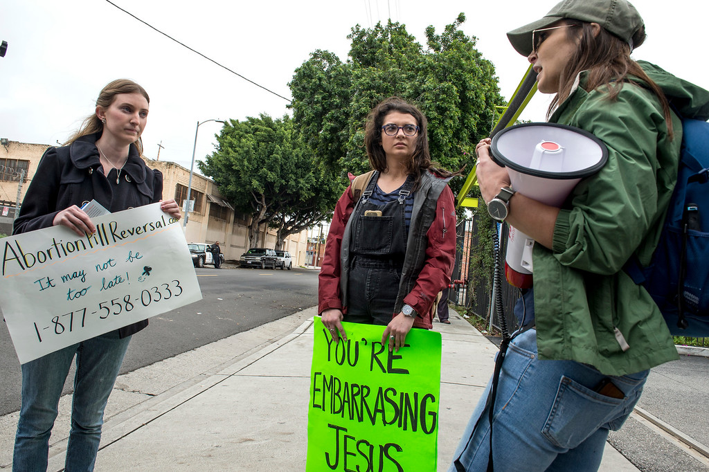 . Ally Maynard, right, Pro-Rights, confronts Lisa Ebiner Gavit, left, Pro-Life, during a Pro-Life Prayer Vigil at Planned Parenthood Bixby Center for Reproductive Health in Los Angeles on Saturday, February 11, 2017. (Photo by Ed Crisostomo, Los Angeles Daily News/SCNG)