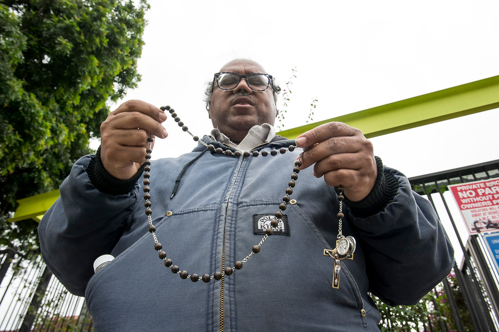 . Christopher Davis, of Los Angeles, continues praying the Rosary during a Pro-Life Prayer Vigil at Planned Parenthood Bixby Center for Reproductive Health in Los Angeles on Saturday, February 11, 2017. (Photo by Ed Crisostomo, Los Angeles Daily News/SCNG)