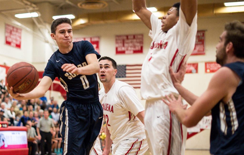 . Pasadena\'s Tyrek Adams (1) tries to stop Sonora\'s Christian Rhodes (0) as he passes behind the basket  during Tuesday night\'s game on February 24, 2015 at Pasadena High School. (Photo by Sarah Reingewirtz/Pasadena Star-News)