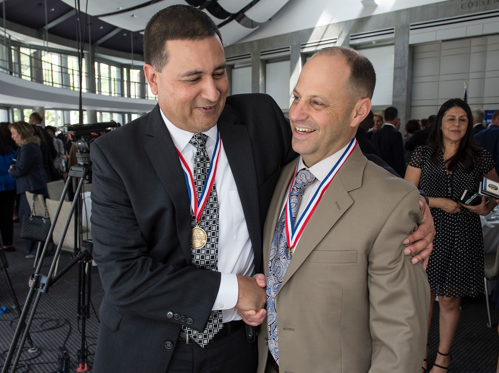 . LAPD Detectives Raul Soto, left, and Carter Fenstemacher, embrace during an awards ceremony, law enforcement personnel to be honored for combating hate and bigotry, at Skirball Cultural Center in Los Angeles on Tuesday, March 14, 2017. The two are honorees for the San Fernando Valley Peckerwoods Takedown. (Photo by Ed Crisostomo, Los Angeles Daily News/SCNG)