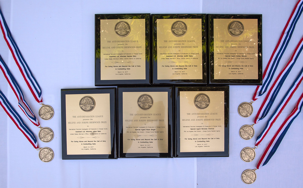 . Awards sit on display before the start of an awards ceremony, law enforcement personnel to be honored for combating hate and bigotry, at Skirball Cultural Center in Los Angeles on Tuesday, March 14, 2017. (Photo by Ed Crisostomo, Los Angeles Daily News/SCNG)