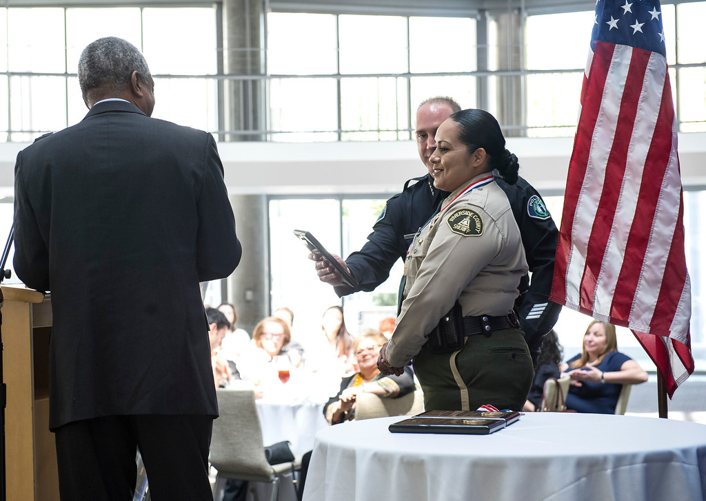 . Riverside County Deputy Sheriff Yadira Perez, right, individual honoree (for Coachella Valley Mosque arson), is all smiles during an awards ceremony, law enforcement personnel to be honored for combating hate and bigotry, at Skirball Cultural Center in Los Angeles on Tuesday, March 14, 2017. (Photo by Ed Crisostomo, Los Angeles Daily News/SCNG)