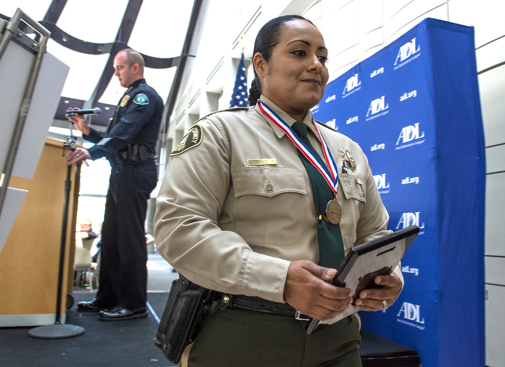 . Riverside County Deputy Sheriff Yadira Perez, right, individual honoree, is all smiles during an awards ceremony, law enforcement personnel to be honored for combating hate and bigotry, at Skirball Cultural Center in Los Angeles on Tuesday, March 14, 2017. (Photo by Ed Crisostomo, Los Angeles Daily News/SCNG)