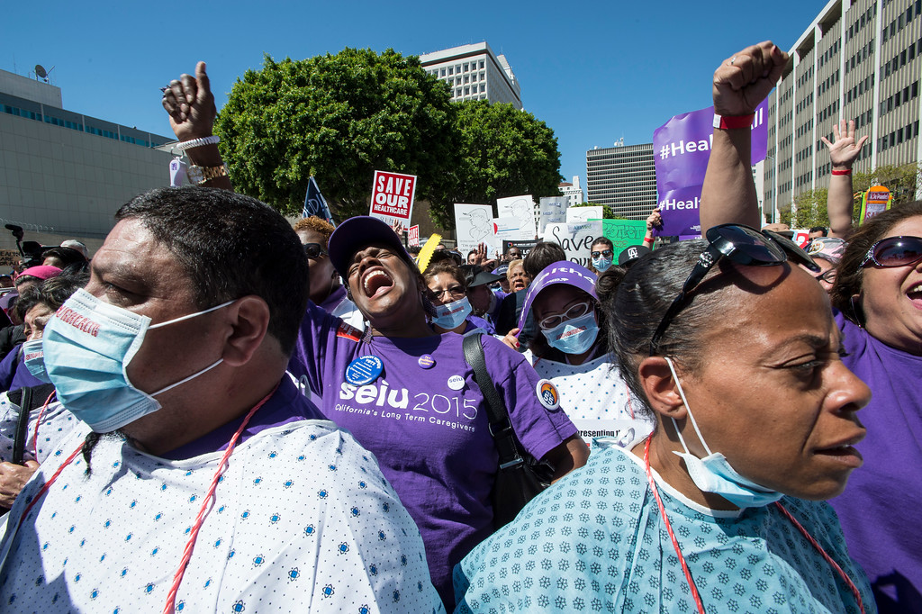 . Felicia Slumkoski, center, of Los Angeles, joins hundreds as they demonstrate and rally to save the Affordable Care Act (ACA) in front of The Edward R. Roybal Federal Building and United States Courthouse in downtown Los Angeles on Thursday, March 23, 2017. (Photo by Ed Crisostomo, Los Angeles Daily News/SCNG)