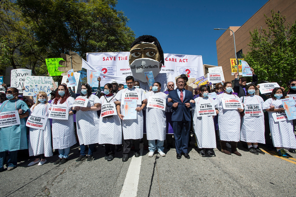 . Councilmember Gil Cedillo, center, joins hundreds as they march towards The Edward R. Roybal Federal Building and United States Courthouse during the save the Affordable Care Act (ACA) rally in downtown Los Angeles on Thursday, March 23, 2017. (Photo by Ed Crisostomo, Los Angeles Daily News/SCNG)
