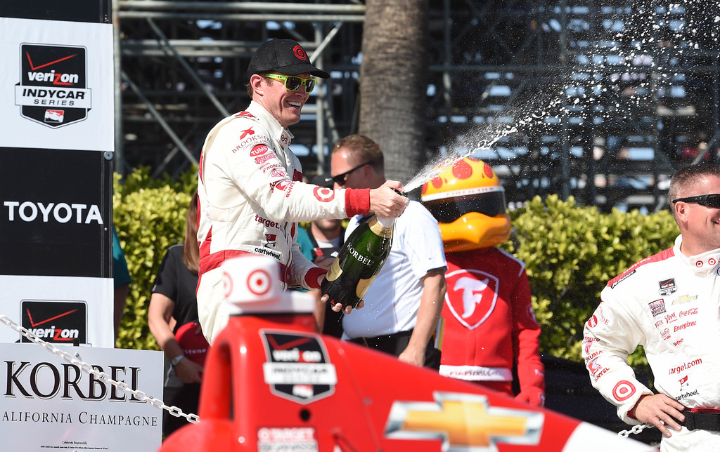 . Toyota Grand Prix of Long Beach winner Scott Dixon sprays champagne on the winners podium, after winning the 41st Annual Toyota Grand Prix of Long Beach.  Long Beach  Calif., Sunday,  April,19, 2015.     (Photo by Stephen Carr / Daily Breeze)